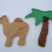 Oasis   Sugar cookies with glace done for Shriner's BBQ. Coconuts are mini m&ms. Camels inspired by bakinccc's!