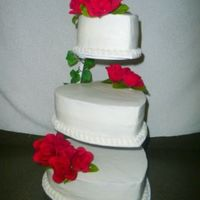 Wedding Cake I used the Floating Tier Stand. Bride wanted a simple wedding cake with red artificial roses. All BC, border is tip 199 shells, w/ tip 14...