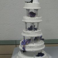 5 Tier Single Layer Round Wedding Cake  this was one of my wedding cakes, each layer was a single layer, buttercream icing, fake flowers between the layers. We had two weddings so...