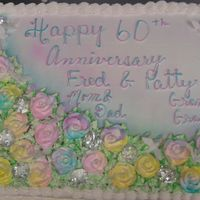 60Th Anniversary, Diamond Anniversary   half sheet, buttercream, all roses are white, and were airbrushed the colors, and has plastic diamond and doves in the roses