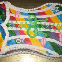 Pride Corsett Cake   this is a gay pride corsett cake, the sides are a ribbon, the boobs are cupcakes, I love the cake but not the boobs, they are bad.