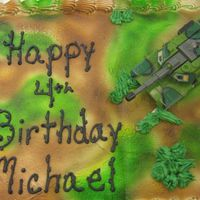 Camo Cake   quster sheet, buttercream, camo was airbrushed, barb wire was done with a number 4 writer tip
