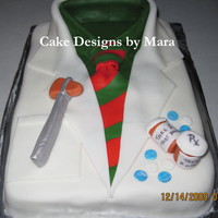 Doctor Coat Christmas Cake This was a yellow cake icing in butterream & covered in fondant with gumpaste accents.