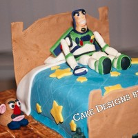Toy Story  I made this cake for my grandson's 3rd birthday. It was inspired by many cakes I saw here, Thanks! The bed is the cake, all of the...