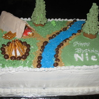 Camping Bday for friend's son that loves to camp. Carrot cake/BC icing. First gumpaste person (thank goodness only 1 dimension). I put a...