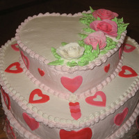 Valentine's Birthday Top tier chocolate cake w/chocolate mouse filling. Bottom is yellow cake w/strawberry filling. Covered in BC with fondant hearts and my 1st...