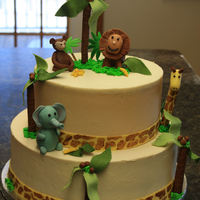 Jungle Baby I had alot of fun with this cake, and surprised myself I could actually make these cute fondant figures. This was for a baby shower and the...