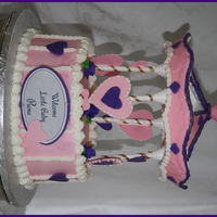Welcome Baby Piana I used the Wilton Carousel Cake Set, I used the hearts instead of the horses, I could not imagine covering those horses in fondat, ALOT of...