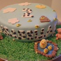 Isabella's 2Nd Birthday Cake 10 inch round chocolate mud cake covered in fondanthandmade fondant farm animalsgreen coloured coconut as grass