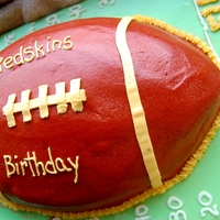 Redskins Birthday Chocolate cake with white chocolate buttercream icing. Covered the board in green fondant. Cake was used for FIL birthday party / football...