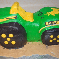 Tractor Birthday Tractor cake for my nephew's 2nd birthday. Was White cake with strawberry filling and lemon buttercream. Only my 2nd 3-D carved cake...
