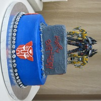 Transformers Birthday Birthday cake for my son and two nephews joint b-day party. Chocolate cake with vanilla buttercream and strawberry filling. Accents were...