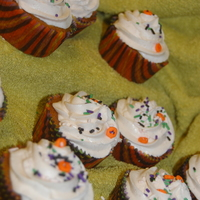 Fall Cupcakes Pumpkin cupcakes with Apple Spice Buttercream icing and sprinkles.