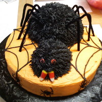 "Spider Halloween Cake I used my ball pan and the mini ball pan to make the body and head of the spider. I put them on a 12"" round. All are iced with..."