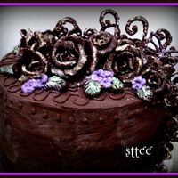 Anniversary Chocolate Style Rich butter 4 layer cake with dark chocolate bc...roses and scrolls made with chocolate candy clay flavored with orange extract and orange...