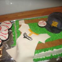 Celebrating 20 Years chocolate cakebuttercream frosting and fondant decorations. The baseball hat(my first attempt) was made out rice krispies