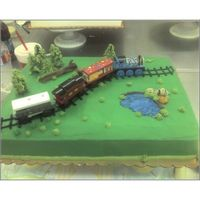 Train Set Cake Yellow sheet cake with buttercream frosting. Wooden train set provided by parent. One of my earlier cakes.
