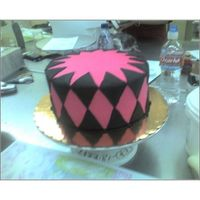 Pink & Black Pink buttercream with black fondant diamonds.. I finished it off with a black gumpaste bow in the center.