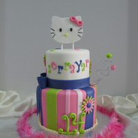 Hello Kitty Fondant covered with fondant decorations. Handmade hello kitty topper. I loved the vibrant colors on this cake!!