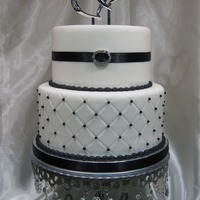 Black And White This was a 2 tier display cake for a bridal show. Fondant covered, sugar pearls and non edible buckle.