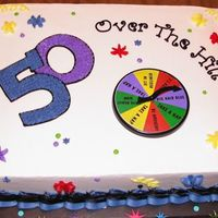 50Th Birthday 1/2 sheet cake iced in buttercream. Plastic spinner decoration.