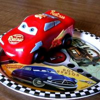 Cars Lightning Mcqueen Disney Cars Lightning McQueen cake carved from small loaf pan cake. Covered in fondant with fondant covered gummy lifesavers for wheels.