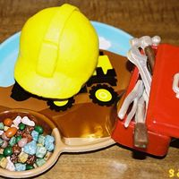 Hard Hat & Tools Hard hat smash cake iced in buttercream. Candy melt tools and box. Chocolate candy rocks.