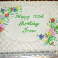 100Th Birthday 1/2 sheet cake iced in buttercream. All buttercream flowers.