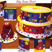 Baby Sesame Street Buttercream frosted cake with fondant letters. Characters placed around the sides of the cake are made from gumpaste. Baby Elmo smash cake...