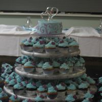 Cupcake Wedding For a friend's wedding - buttercream with candy mold hearts. The couple opted for a topper cake to cut for the reception.