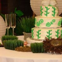 Green Wedding Cake This is a pre-made wedding cake from Wal-Mart, I just decorated it with buttercream and fondant accents. The vine idea was taken from a...