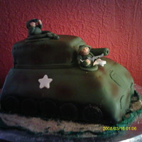 """in A Tank"" This cake was made for my nephew's fourth birthday. It's covered in rolled fondant and completely edible (even the men)."