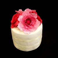 Peonies And Roses Gumpaste peonies and roses. Was made as a cut cake for a cupcakes wedding. First time making the peonies and after a few trial and error...