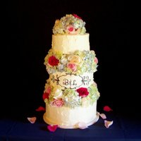 Bunches Of Hydrangeas Buttercream iced cake with real hydrangeas and roses.
