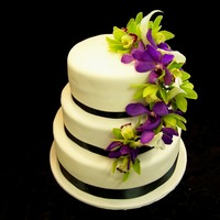 Orchid Wedding real flowers were used on this cake. They were some cala lilies, green cymbidium orchids and some other purple orchid. They were all wired...