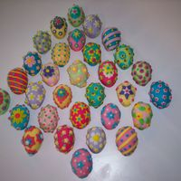 Easter Eggs These were made with the Wilton mini egg pan. Two egg halves put together, covered in very thin fondant, and all fondant decorations. Each...