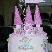 "Katie's 3Rd Birthday Cake Three 9"" rounds in buttercream. I had some cake trouble and ended up running out oftime on the towers. I used pink marshmallows on..."