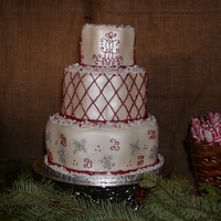 My First Wedding Cake This was my first wedding cake. It was for a friend of mine who was having a Christmas themed wedding. Whole cake was white chocolate with...