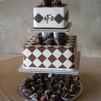 Ivory And Chocolate Checkerboard Iced in BC, decorated with fondant cut-outs. Garnished with chocolate covered strawberries.