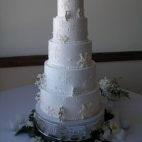 Snowflake Wedding Cake This was smoothly iced with a whipped vanilla icing. It's decorated with edible gold and silver flakes, snowflakes embossed into the...
