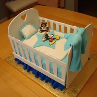 Baby Boy Crib Cake Gumpaste crib, pound cake covered in MMF. Fondant and colorflow decorations.