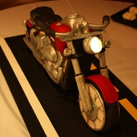 Motorcycle Grooms Cake Replica of grooms motorcycle requested by bride for their rehearsal dinner. Chocolate chip cake, buttercream filling, with MMF and gumpaste...