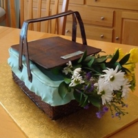 Basket Cake Cake was made to honor the 50th birthday of a basket collector. Except for the flowers, cake was 100% edible. Butter pound cake w/...