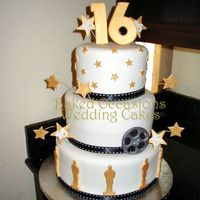 Sweet 16 Hollywood Style   This cake is white fondant with black ribbon made to look like movie film. Oscars, stars and film reel are made fondant with Tylose.