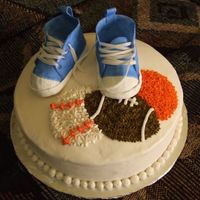 Sports Baby Shower sports theme baby shower, gumpaste shoes on vanilla cake with bc icing
