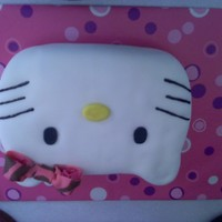 Hello Kitty! Hello Kitty cake for my friend Ciara! Very very easy to make. Simply used a 13x9 pan and took and knife and shaped the ears. Covered in...