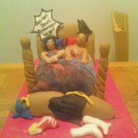 """oh Wonderwoman!"" My friend Ciara and I made this cake for this contest. This is our first attempt at people! It was all done in fondant covered chocolate..."