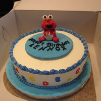 Elmo Galore  Elmo themed birthday cake for a little sweet boy celebrating his first birthday. 10in cake filled with strawberry jam & buttercream...