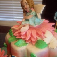 "Fairy ""Fairy themed cake for my 8th yr. old niece. Fairy shaped from gumpaste, saw the article here in CakeCentral 'bout how to make a..."