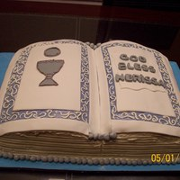 First Communion Cake  First Communion book cake for a little girl, white cake on one side the other one is yellow cake. Covered in butter cream with strawberry...